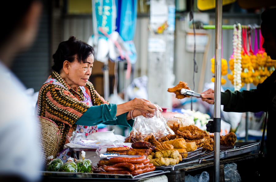 The woman that sells sticky rice and fried chicken on Moon Mueng Road in Chiang Mai, Thailand