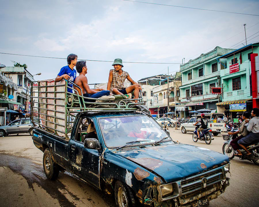 Burmese workers arriving back to town after a day of working the fields of Myanmar.