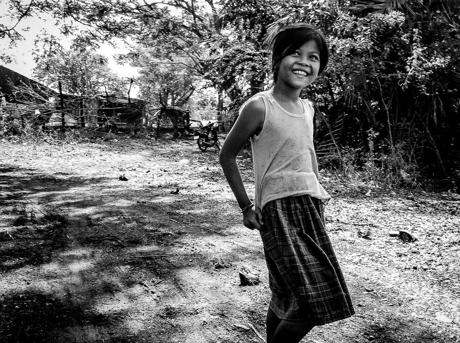 A young girl with a bright smile in Battambang, Cambodia.