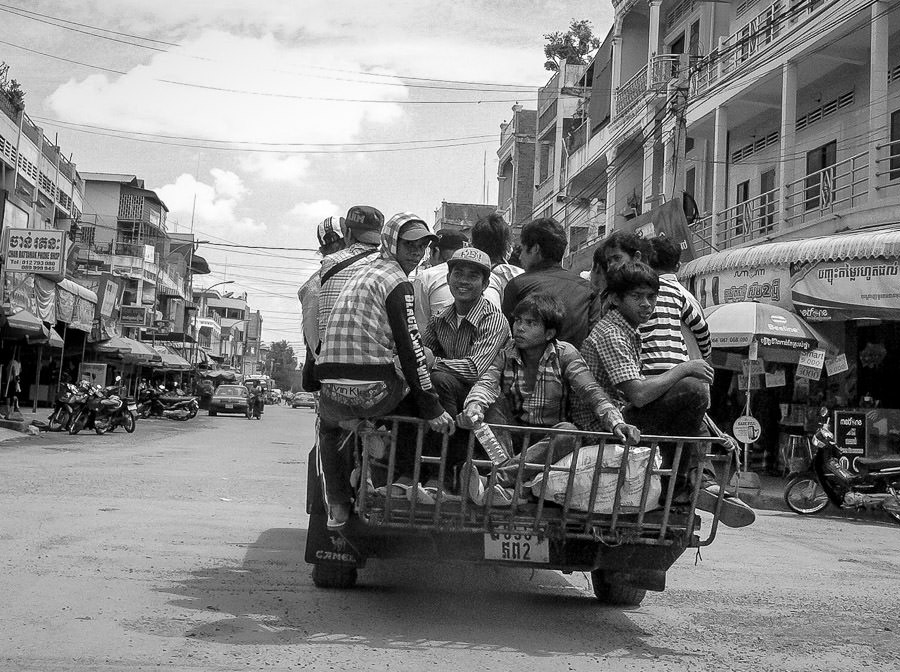 A truck loaded with workers drives down the street in Battambang, Cambodia.
