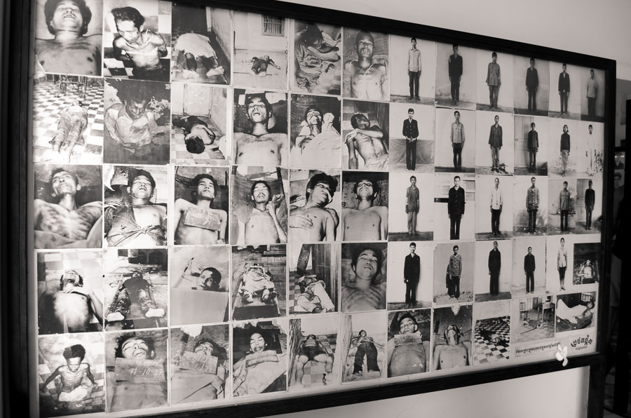 A board of photos on display at Tuol Sleng Prison in Phnom Penh depicting victims of the Khmer Rouge