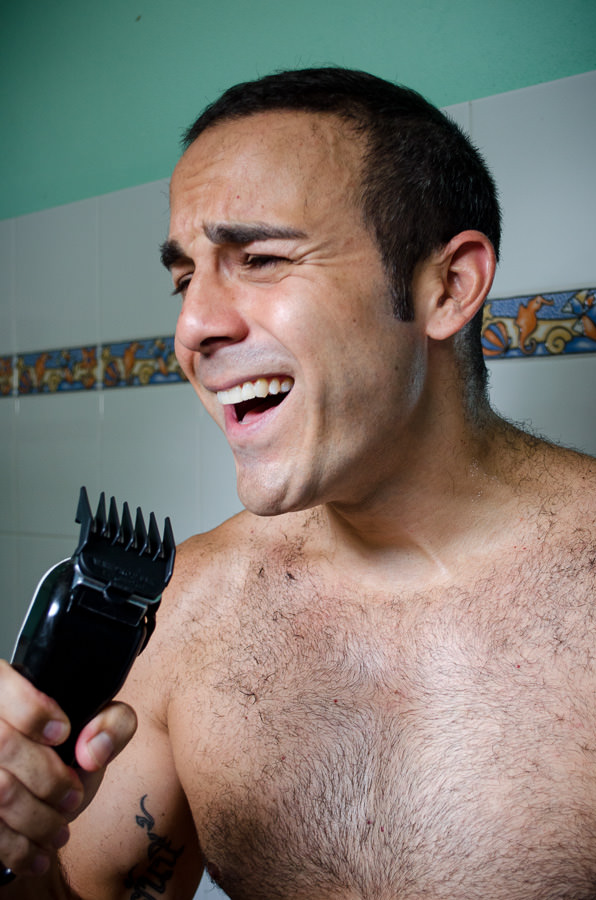 Adrian singing into the electric razor.