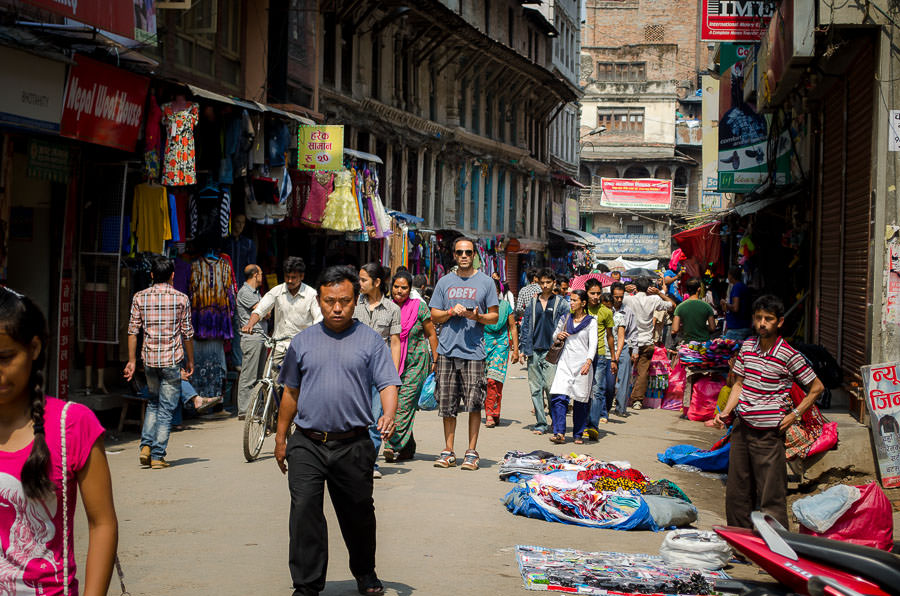 Adrian standing in the middle of a busy road in Kathmandu, Nepal.