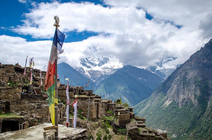 Prayer flags flying over the cobblestone village of Ghyaru, Nepal.