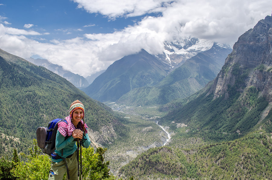 Ashlie posing for a photo overlooking the valley outside of Pisang, Nepal