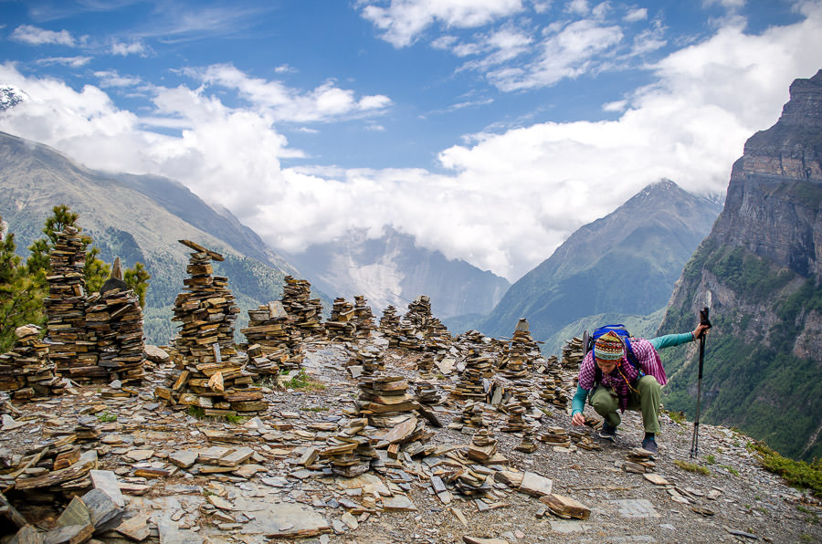 Ashlie stacking rocks for our family on the Annapurna Circuit