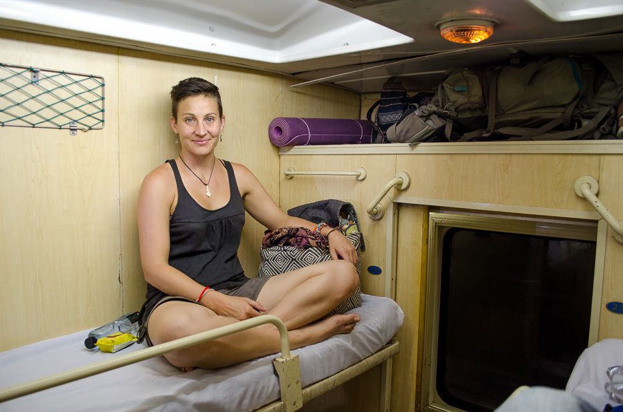 Ashlie sitting on her bunk in the night train.