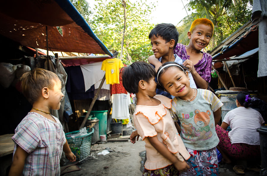 Children playing around for the camera. Myanmar.
