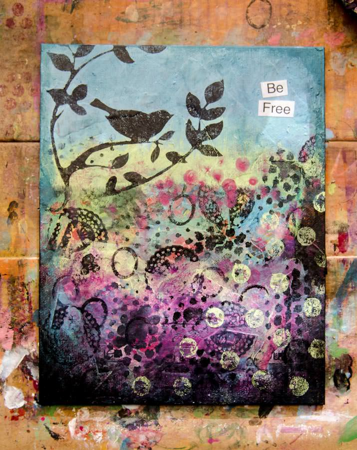 A mixed media canvas that says Be Free